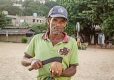 A poor local man sells coconut. In Sri Lanka Stock Photo