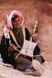 Poor man, Jordan. Poor man playing his music instrument at Petra in Jordan royalty free stock photography