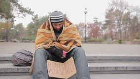 Poor man asking for charity in city park, miserable homeless person needs help. Stock footage stock video footage