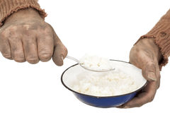 Poor man eats rice Stock Image
