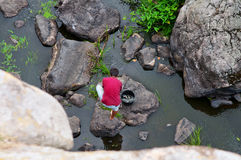 Poor man fishing in the river. Top view royalty free stock photo