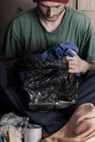 Poor man with garbage bag in hand Stock Photo