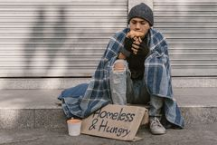 Free Poor Man Homeless With Dirty Hands Eating Piece Of Bread In Modern Capitalism Society Stock Image - 166872701