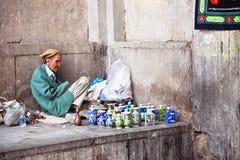 Poor man seling vases, Esfahan, Iran. Stock Image