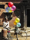 Poor man selling balloons. Poor man selling colorful balloons stock photography