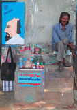 Poor man is selling his pictures outdoor in Kochi, India royalty free stock image