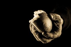 Poor Man sharing Bread, Helping Hand Concept. Aged photo Amber. Details stock photos