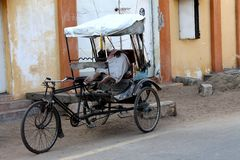 Poor man sleeping in his cycle rickshaw Stock Photo