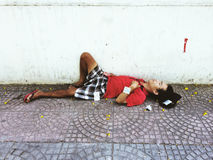 Poor man sleeping on the street Stock Photos