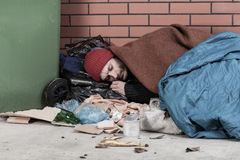 Poor man sleeping on the street Stock Image