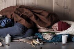 Poor man sleeping on the street Stock Image