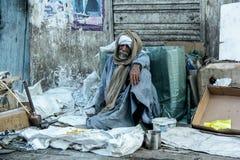 Poor man on street stock photos