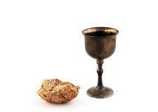 Poor meal. A piece of dark bread an an old goblet Stock Photo