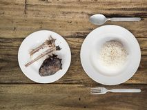 Poor meal of rice and fish bones. Stock Photos