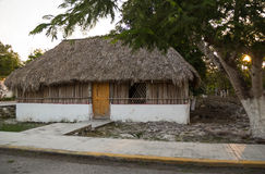 Poor Mexican hut with straw roof. Wooden and straw house in Mexican village Stock Photo