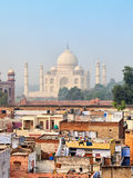 Poor neighborhoods and luxurious Taj Mahal. Agra, India Stock Photography