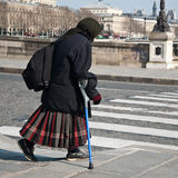 poor old gipsy woman with crutch Stock Photos