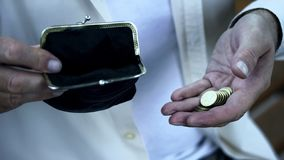 Poor old man counting last money from wallet, lack of finance, small pension. Stock photo stock photo