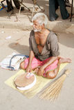 Poor old man in India. Old man sitting, with a weighing machine,waiting for people to check thier weight for small payment.This is a common scene and type of stock image
