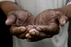 The poor old man`s hands beg you for help. The concept of hunger or poverty. Selective focus. Poverty in retirement. Alms royalty free stock photos