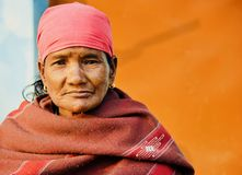 A poor old woman unique portraits photo. A village woman wearing traditional dress sitting in a place unique portraits photo royalty free stock images