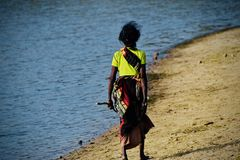 Poor old woman walking in the river bank area photograph royalty free stock photography