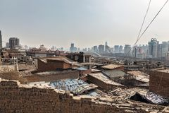 Poor part of chinese city. With developed buildings in the background Royalty Free Stock Image