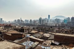 Poor part of chinese city. With developed buildings in the background Stock Photography