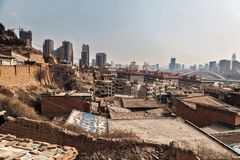 Poor part of chinese city. With developed buildings in the background Royalty Free Stock Images