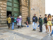 Poor people beg for an alm in front of the basilica de la cathed Stock Images