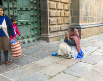 Poor people beg for an alm in front of the basilica de la cathed Stock Photo