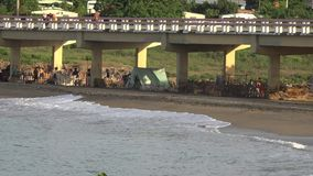 Poor People in Cuba Spending their Vacation Under a Bridge to Enjoy the Beach stock footage