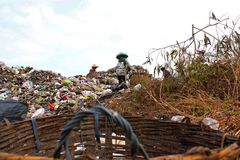 Poor people find or searching garbage in landfill royalty free stock image