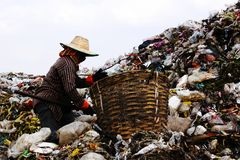 Poor people find or searching garbage. For sell to reuse and recycle in landfill. This life and living Stock Photos