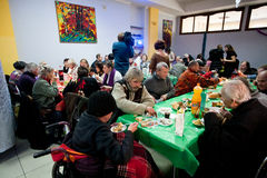 Poor people have lunch at the Christmas charity dinner for the homeless Stock Photos