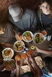 Poor people holding food indoors. View from above stock images