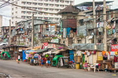 Poor people living in destroyed buildings near the road in Mani Royalty Free Stock Photo