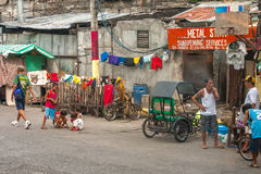 Poor people living in destroyed buildings near the road in Mani Royalty Free Stock Photography