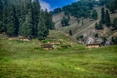 Huts in hills royalty free stock photo