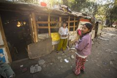 Poor people near their houses at slums in Tripureshwor district. Royalty Free Stock Photo
