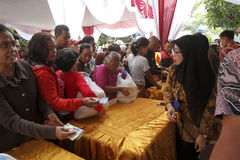 Poor people. Queued for food aid in the city of Solo, Central Java, Indonesia Royalty Free Stock Photos