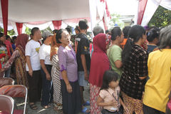 Poor people. Queued for food aid in the city of Solo, Central Java, Indonesia Royalty Free Stock Photo