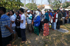Poor people. Queued to get food before the Eid celebration at a park in the city of Solo. Central Java, Indonesia Royalty Free Stock Images