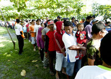 Poor people. Queued to get zakat to celebrate Eid al-Fitr in the city of Solo, Central Java, Indonesia Stock Photo