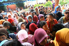 Poor people. Queuing up to get a free rice in the city of Solo, East Java, Indonesia Stock Photography