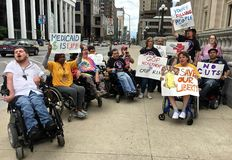 Members of ADAPT of Indiana fear loss of Medicaid money stock images