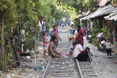 Poor people in Bangkok. Thailand is the most developed country among ex Indochina countries. But still there are many poor people. There are slums in the heart Stock Image