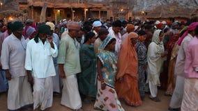 Poor people on village road stock video footage