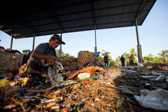 Poor people working in a scavenging at the dump Stock Photography