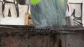 Poor person cooking on old grill grate on bonfire, unsanitary conditions. Stock footage stock video footage